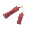 Rode tassel clip van Mutts & hounds